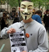 Anonymous member holding poster